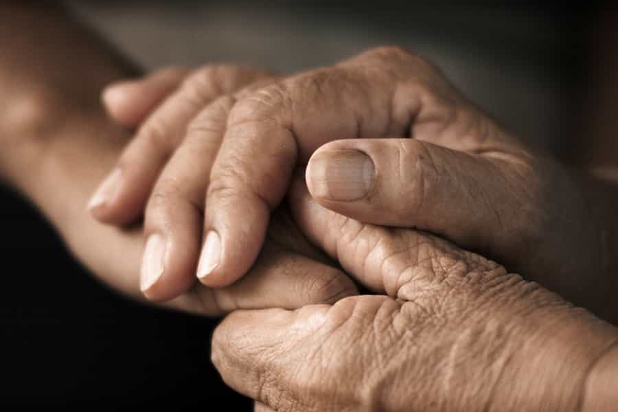 Holding hands in support of each other in addiction recovery